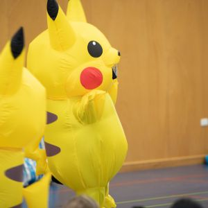 Children from the JAM Band audience dressed in blow up Pikachu costumes
