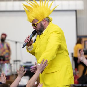 Jono Ruse dressed as the sun performing in a JAM Band show